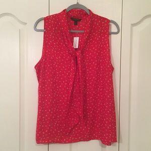 Tie neck sleeveless blouse. NWT